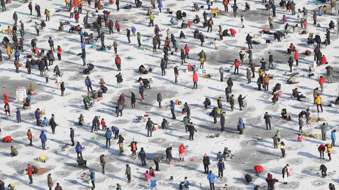 Anglers in Hwacheon-gun, South Korea, cast their lines through a frozen river during the Mountain Trout Ice Festival on Saturday, January 10.