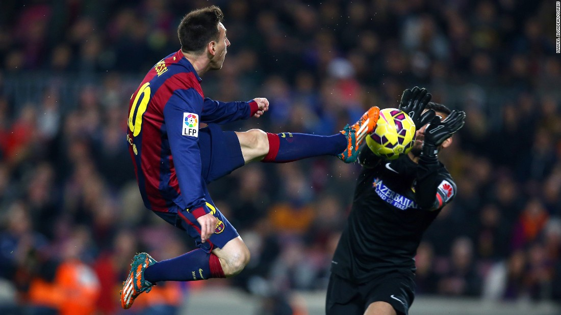 Barcelona forward Lionel Messi, left, and Atletico Madrid goalkeeper Miguel Angel Moya compete for the ball during a league match in Barcelona, Spain, on Sunday, January 11.