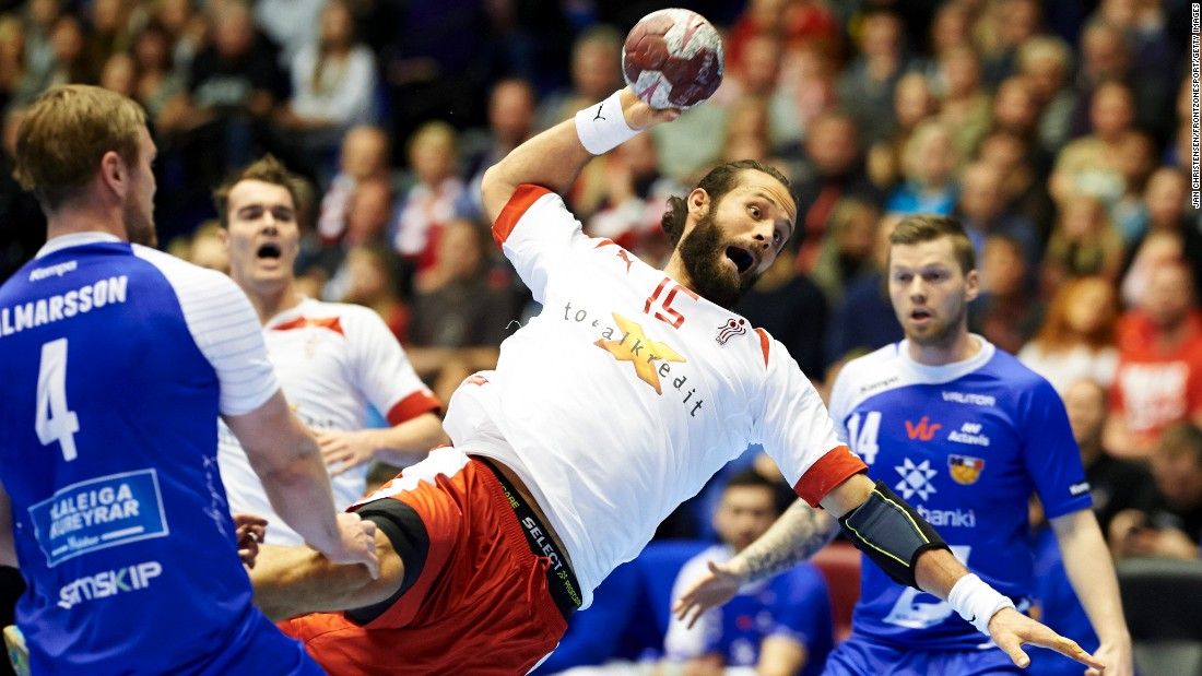 Danish handball player Jesper Noddesbo prepares to throw the ball against Iceland during a Totalkredit Cup match played Saturday, January 10, in Aalborg, Denmark.