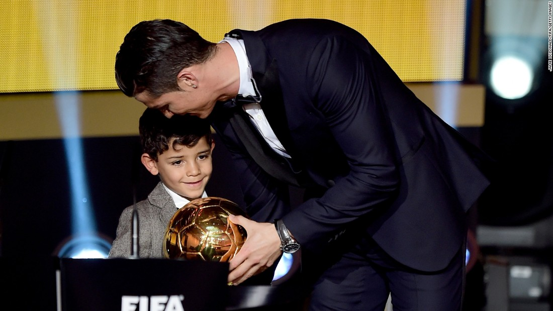 "Soccer star Cristiano Ronaldo <a href=""http://www.cnn.com/2015/01/12/football/fifa-ballon-dor-winner-2014/"" target=""_blank"">accepts the FIFA Ballon d'Or</a> with his son, Cristiano Jr., at a ceremony in Zurich, Switzerland, on Monday, January 12. The award is given annually to the world's best player as chosen by a panel of players, coaches and media members. This is Ronaldo's third Ballon d'Or and second in a row."
