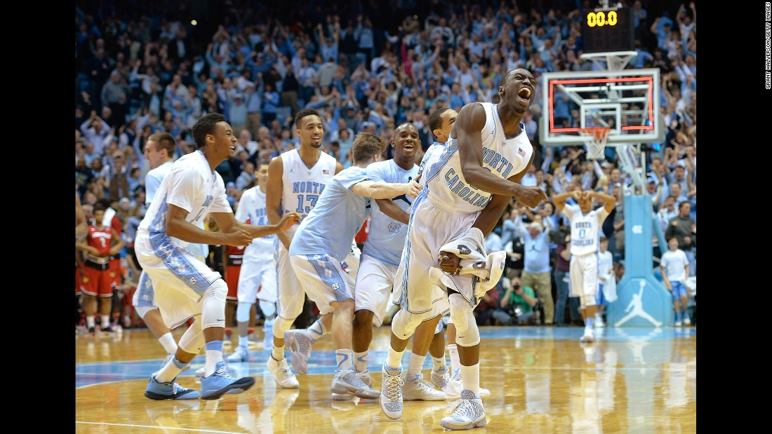 The North Carolina basketball team celebrates after defeating Louisville in a game played Saturday, January 10, in Chapel Hill, North Carolina. Point guard Marcus Paige scored the game-winner with 8.5 seconds left.