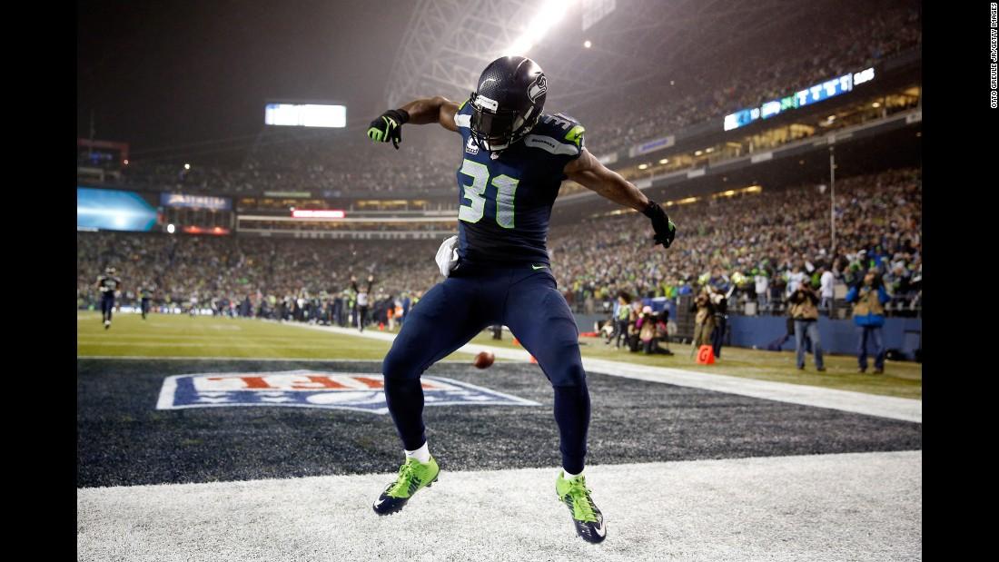 Seattle Seahawks safety Kam Chancellor celebrates after he returned an interception for a touchdown during a home playoff game against Carolina on Saturday, January 10. The Seahawks, the defending NFL champions, advanced to the conference title game with a 31-17 victory.
