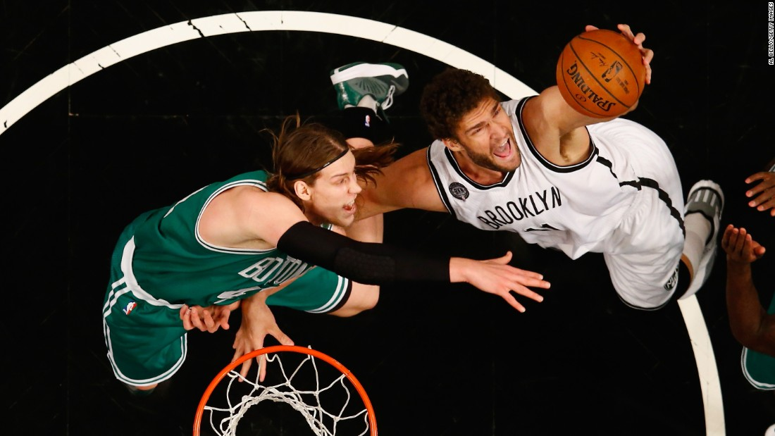 Boston's Kelly Olynyk, left, and Brooklyn's Brook Lopez battle for a rebound during a game in New York on Wednesday, January 7.