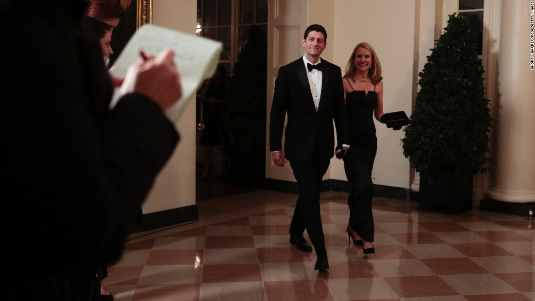 Ryan and his wife, Janna, arrive at a state dinner at the White House in honor of French President Francois Hollande on February 11, 2014 .