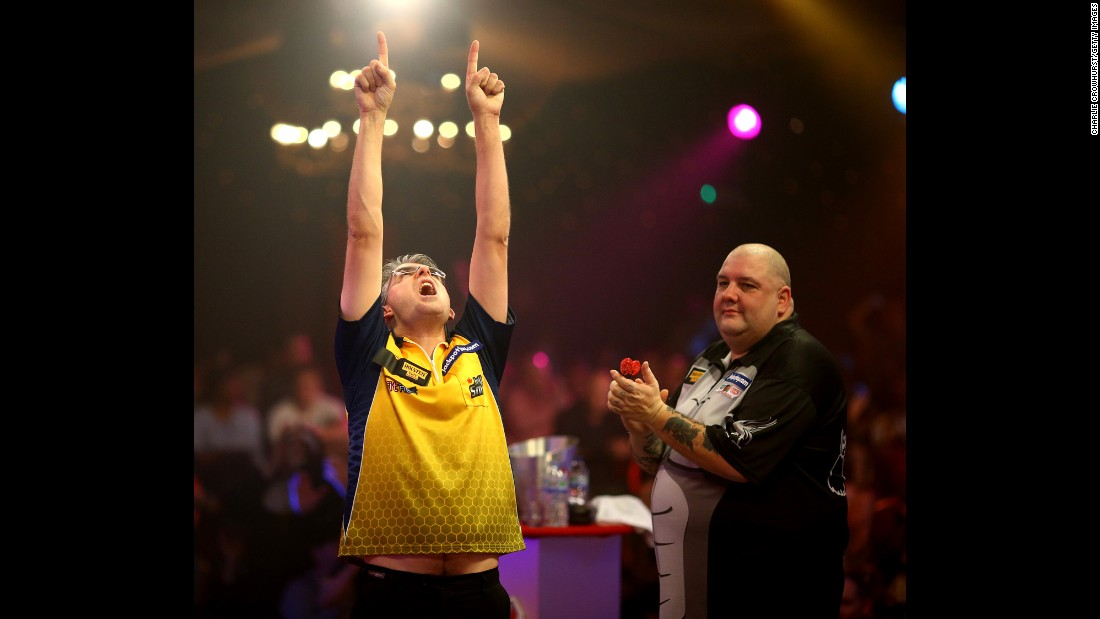 Jeff Smith celebrates after defeating Robbie Green in the quarterfinals of the BDO World Darts Championship on Friday, January 9. The tournament, which took place in Frimley, England, was won by Scott Mitchell.