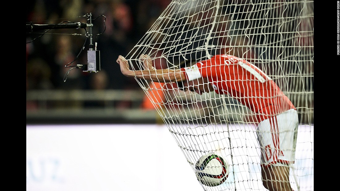 Benfica midfielder Nicolas Gaitan celebrates inside the net after scoring a goal against Vitoria during a league match in Lisbon, Portugal, on Saturday, January 10. Benfica won 3-0 to stay in first place by six points.