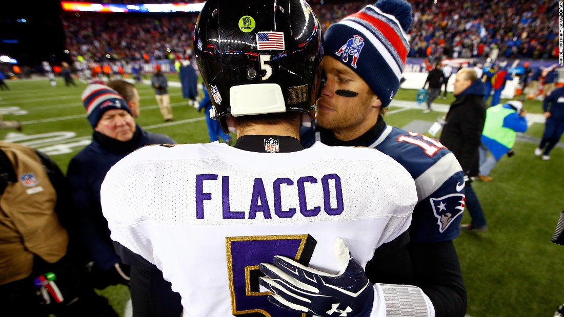 New England Patriots quarterback Tom Brady embraces Baltimore Ravens quarterback Joe Flacco on Saturday, January 10, after the Patriots defeated the Ravens 35-31 in Foxborough, Massachusetts.