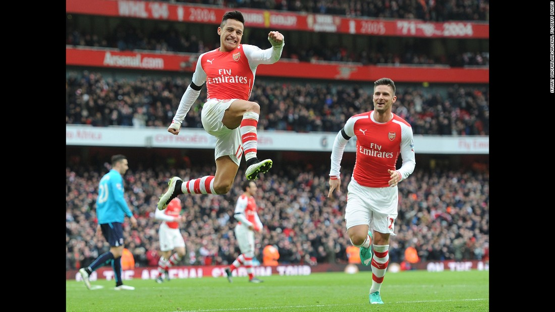 Arsenal's Alexis Sanchez leaps in the air after scoring a goal against Stoke City during a home match in London on Sunday, January 11. Sanchez had two goals in the game as Arsenal won 3-0.