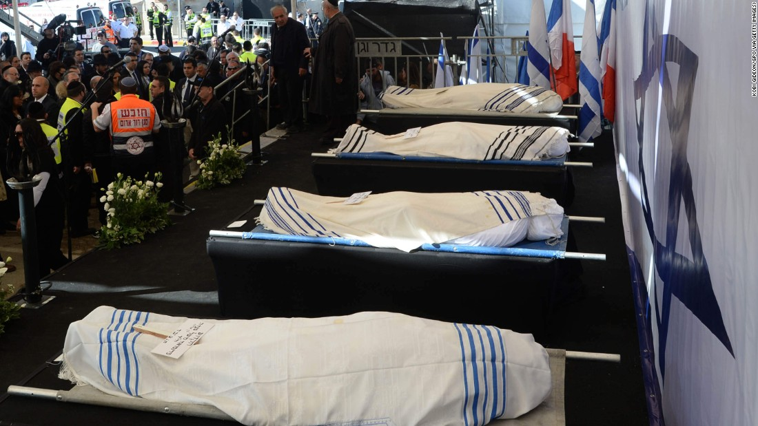 The bodies of Hattab, Yohan Cohen, Philippe Braham, and Francois-Michel Saada are laid out for their funeral in Jerusalem.