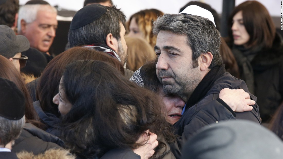 Israeli mourners hug at the funeral in Jerusalem on January 13, 2015 of four French Jews, Philippe Braham, Yohan Cohen, Yoav Hattab and François-Michel Saada, killed in an attack on a kosher supermarket in Paris last week.