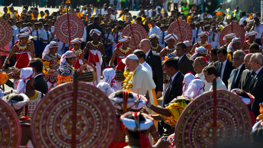 Pope Francis is received by colorful Sri Lankan dancers upon arrival in the capital Colombo on January 13.