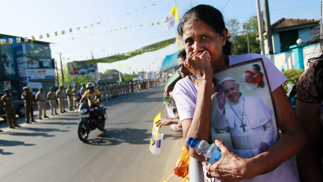 A Sri Lankan Catholic holds a portrait of Pope Francis and awaits his arrival, on the outskirts of Colombo, Sri Lanka, on January 13.