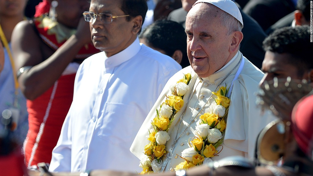 Pope Francis (R) stands alongside Sri Lankan President Maithripala Sirisena (L) during a welcome ceremony at the Bandaranaike International Airport in Katunayake, Sri Lanka on January 13. Sri Lanka is the first stop in his two-nation tour in Asia. He will continue on to the Philippines, the largest Catholic majority nation in Asia, where he is expected to draw huge crowds during his visit from January 15 - 19.