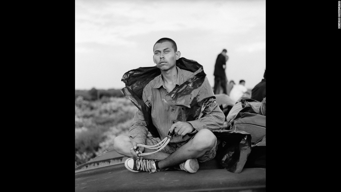 A Salvadoran migrant holds a slingshot in Mexico in July 2010. From 2009 to 2014, Michelle Frankfurter photographed Central American migrants traveling through Mexico en route to the United States.