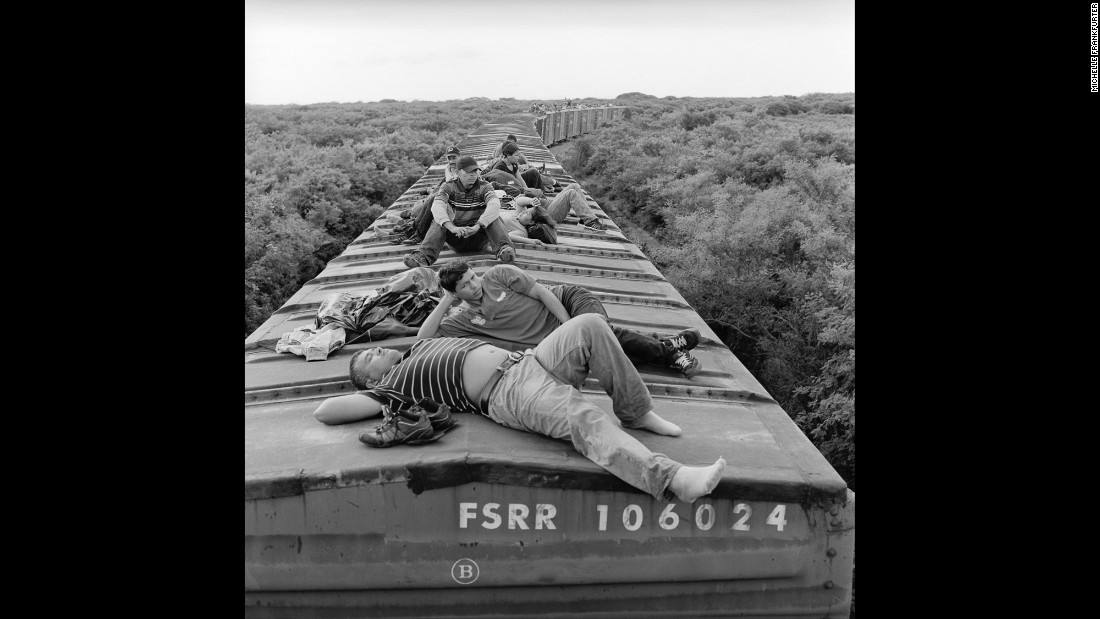 Migrants ride a northbound freight train through the southern Mexican state of Oaxaca in July 2010.