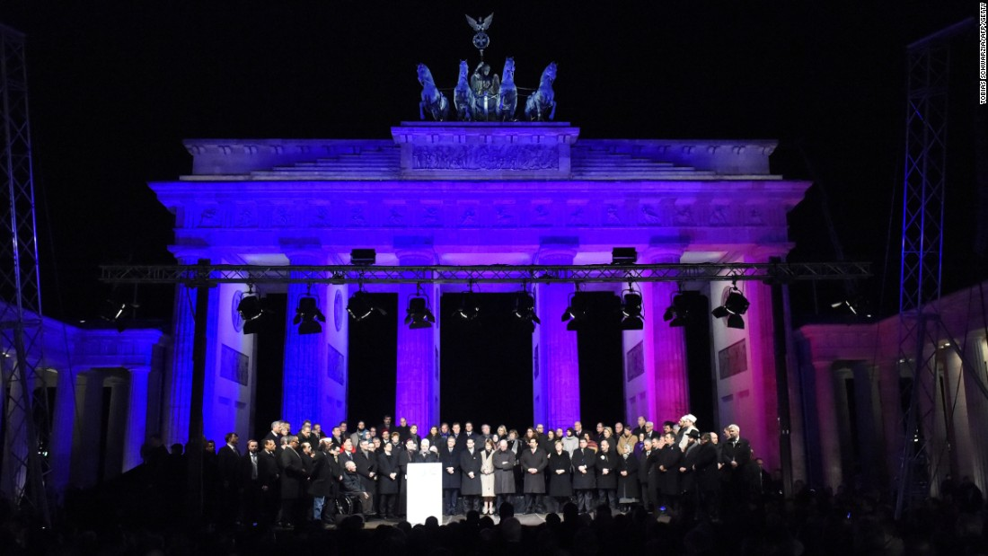 German President Joachim Gauck gives a speech in front of Berlin's Brandenburg Gate as political and religious leaders attend a Muslim rally to condemn the Paris terror attacks, promote tolerance and send a rebuke to a growing anti-Islamic movement on Tuesday, January 13.