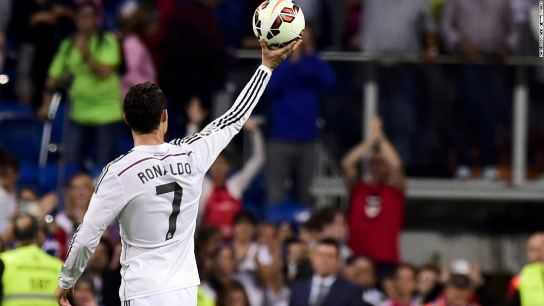 September 24: Ronaldo takes the game ball after his third hat trick of the 2014-15 season, against Bilbao.