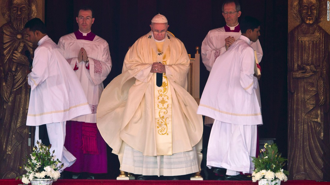 Pope Francis stands during Mass in Colombo on January 14.