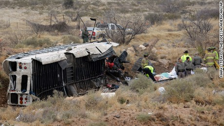 Officials investigate the scene of  the bus-train collision in Penwell, Texas.