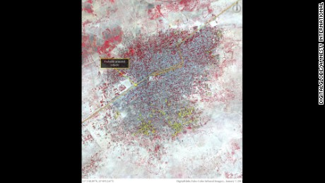 This image shows more than 620 damaged or destroyed structures, represented by yellow dots, predominantly located in the southern portion of Baga on January 7. Amnesty International says vehicle activity is present along the main road, possibly including an armored vehicle stationed at a roadblock close to the center of town.