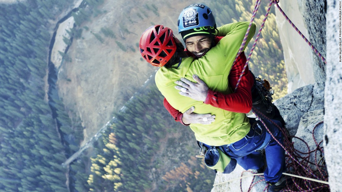 Free climbers Tommy Caldwell, left, and Kevin Jorgeson embrace Wednesday, January 14, after reaching the top of El Capitan, a 3,000-foot rock formation in California's Yosemite National Park. They are the first to successfully climb El Capitan's Dawn Wall using only their hands and feet.