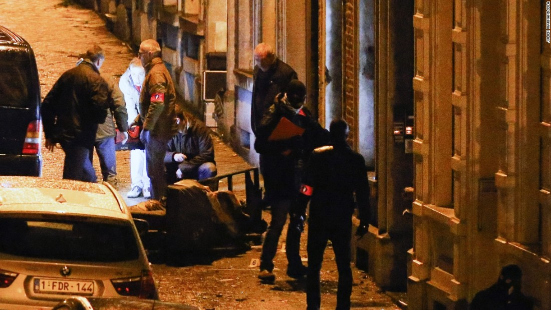 Police officers gather at the scene of an anti-terrorism operation in Verviers, Belgium, on Thursday, January 15. Two people were killed during a raid on a suspected terror cell, Belgian authorities said. A third suspect was injured and taken into custody.