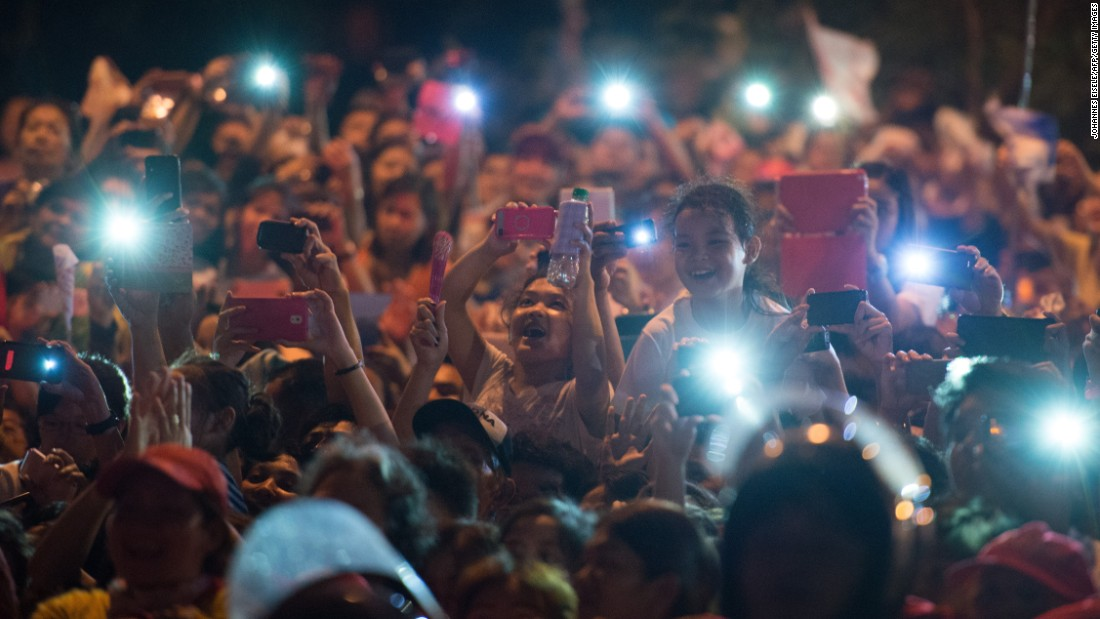 Well-wishers use their cell phones to try to capture the arrival of Pope Francis in Manila on January 15. In the Philippines, 80% of the population is Catholic.