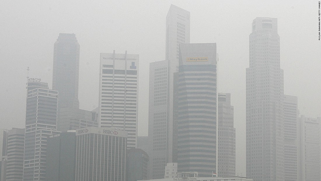Singapore's skyscrapers enveloped in smog, 16 October 2006, from forests fire in Indonesia. The annual recurrence of carbon-rich haze caused by fires in Indonesia's vast tropical peatlands may help fuel global warming if left unchecked, experts have warned.