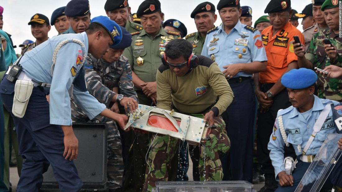 "A flight data recorder from <a href=""http://www.cnn.com/2014/12/28/asia/gallery/airasia-missing-plane/index.html"" target=""_blank"">AirAsia Flight QZ8501</a> is retrieved from the Java Sea on Monday, January 12. The passenger plane was traveling from Surabaya, Indonesia, to Singapore when it lost contact with air traffic control on December 28. There were 162 people aboard."