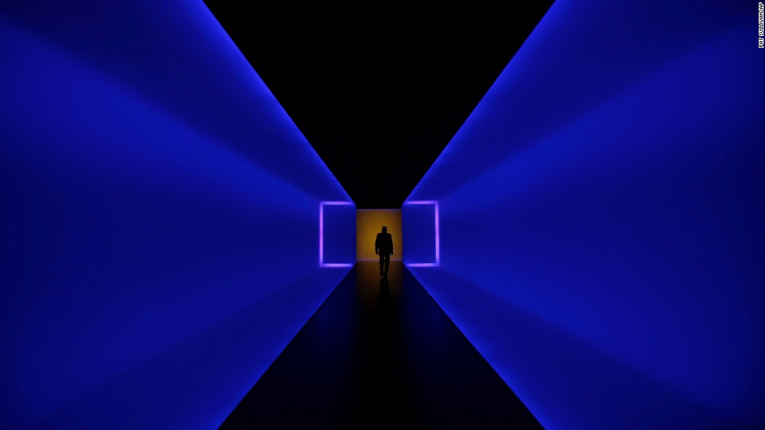 "A man in Houston walks through a tunnel that connects two buildings at the Museum of Fine Arts on Tuesday, January 13. The tunnel, ""The Light Inside,"" is the work of American artist James Turrell."