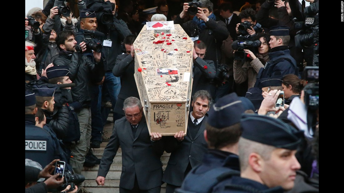 Pallbearers carry the casket of Bernard Verlhac, a cartoonist known as Tignous, at the city hall of Montreuil, France, on Thursday, January 15.