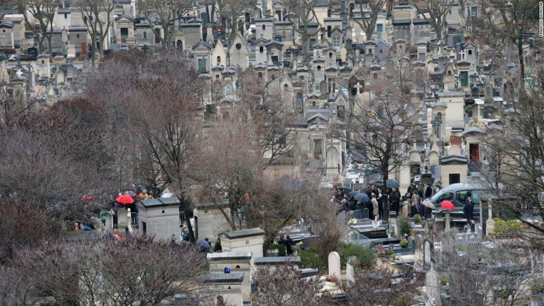 Relatives gather in Paris for the burial of cartoonist Georges Wolinski on January 15.