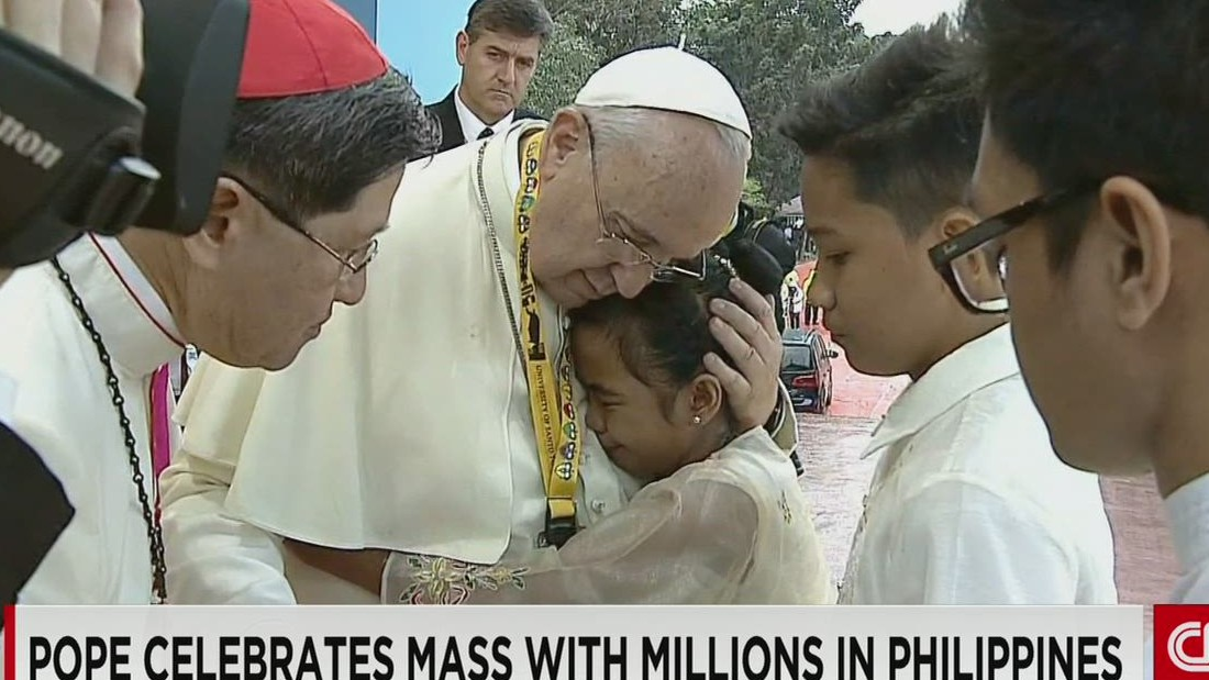 Ex-street kid weeps as she asks Pope why God lets children suffer in Philippines