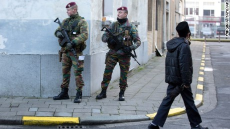 Belgian para-commandos patrol near a synagogue in the center of Antwerp, Belgium, on Saturday, Jan. 17, 2015. Security around Belgium has been stepped up after thirteen people were detained in Belgium in an anti-terror sweep following a firefight in Verviers, Belgium, in which two suspected terrorists were killed. (AP Photo/Virginia Mayo)