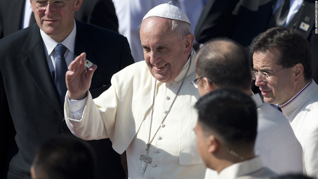 Pope Francis waves to the crowd during a departure ceremony at Villamor Air Base in Manila, Philippines, on Monday, January 19. Francis concluded a weeklong trip to Asia which included visits to Sri Lanka and the Philippines.