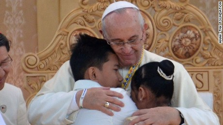 Pope Francis hugging two former street children at a ceremony in Manila, Philippines, on Sunday.