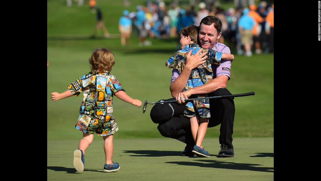After winning the Sony Open, pro golfer Jimmy Walker celebrates with his sons, Mclain and Beckett, on Sunday, January 18. It was the second straight year that Walker won the event, which is held at Waialae Country Club in Honolulu.