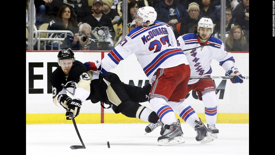 New York Rangers defenseman Ryan McDonagh checks Pittsburgh's Nick Spaling during an NHL game played in Pittsburgh on Sunday, January 18.