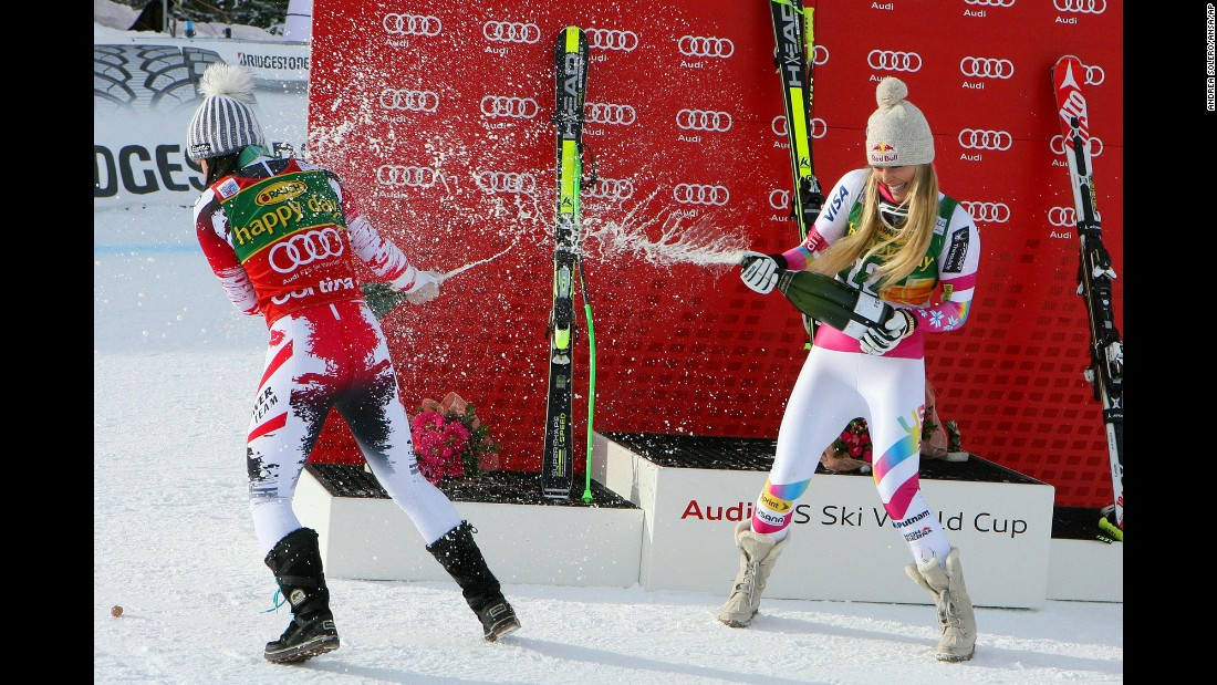 American skier Lindsey Vonn, right, and Austrian skier Anna Fenninger spray champagne on each other Monday, January 19, after finishing first and second in a World Cup race in Cortina d'Ampezzo, Italy. Vonn's win in the super-G was her record 63rd World Cup victory.