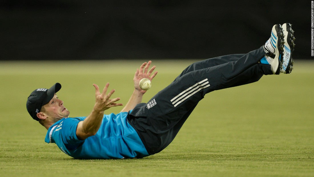 English cricket player Chris Woakes juggles the ball off his feet as he makes a catch Wednesday, January 14, during a match between England and the Prime Minister's XI in Canberra, Australia.