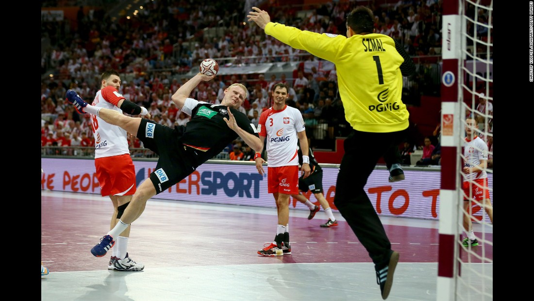 Patrick Wiencek of Germany scores a goal against Slawomir Szmal of Poland at the World Handball Championship on Friday, January 16. The tournament is taking place in Qatar.