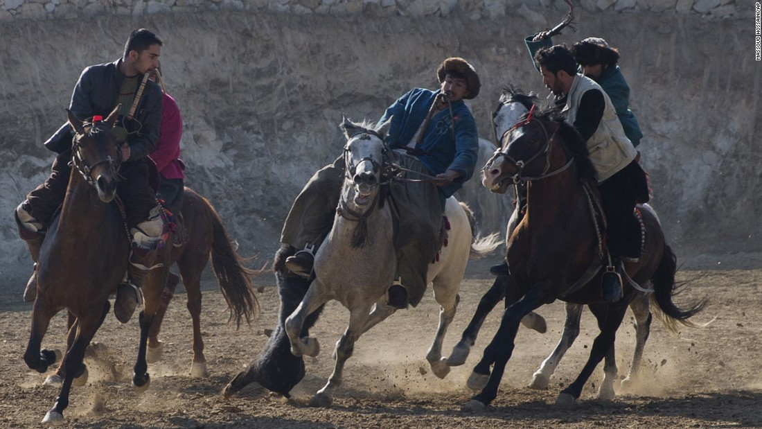 Horse riders compete for the goat during a buzkashi match on the outskirts of Kabul, Afghanistan, on Thursday, January 15. In buzkashi, the national sport of Afghanistan, players compete to place a goat carcass into a goal circle.