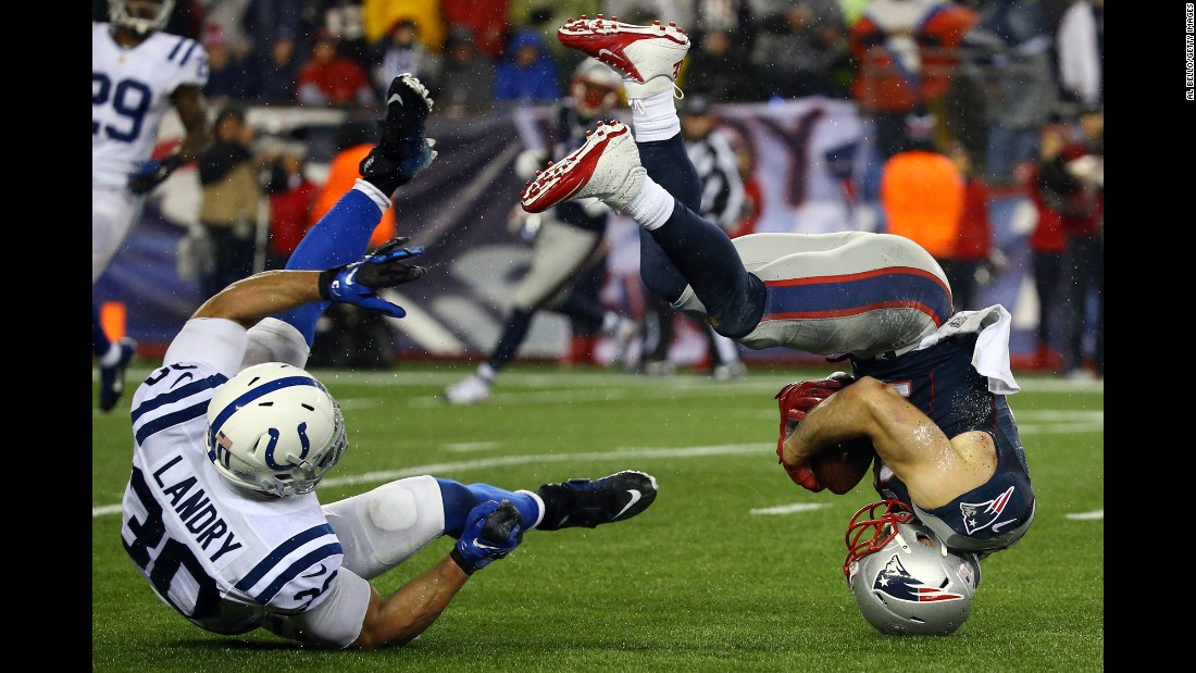 New England wide receiver Julian Edelman flips over after making a catch during the AFC Championship on Sunday, January 18.