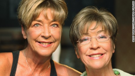 The real Anne Kirkbride, left, poses with her Madame Tussaud's waxwork version in 2011.