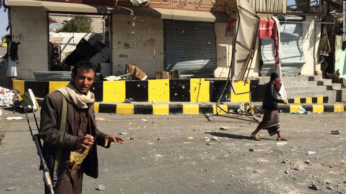 An armed member of the Houthi movement stands guard in the streets of Sanaa on January 20.