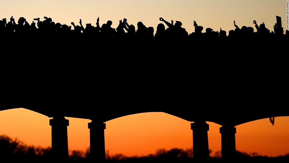 JANUARY 19 - SELMA, ALABAMA: Thousands march across the Edmund Pettus Bridge along with cast members of the movie 'Selma' in honor of Dr. Martin Luther King Junior Day. In 1965, King led nonviolent protestors on a march through Selma to Montgomery in a historic civil rights demonstration.
