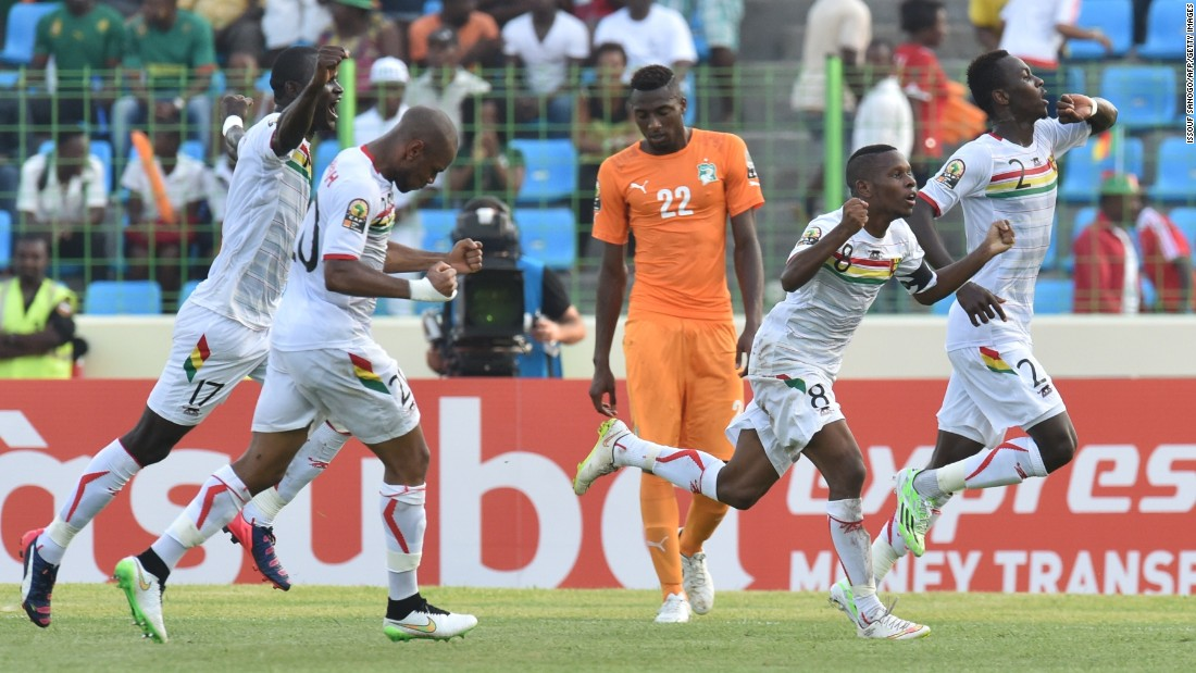 Guinea's players celebrate after scoring a goal against Ivory Coast during the African Cup of Nations group D tie on Tuesday. The match finished 1-1.