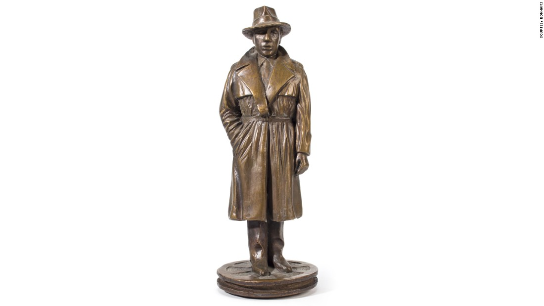 "This bronze figure of Humphrey Bogart portrayed as the character Sam Spade in the film ""The Maltese Falcon"" has piqued the interest of collectors and fans alike."