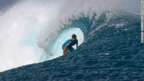 Caption:Brazil's Ricardo Dos Santos competes during his round one heat at the Billabong Pro Tahiti in the southern Pacific ocean island of Tahiti, French Polynesia, on August 26, 2012 in Teahupoo. AFP PHOTO GREGORY BOISSY (Photo credit should read GREGORY BOISSY/AFP/GettyImages)