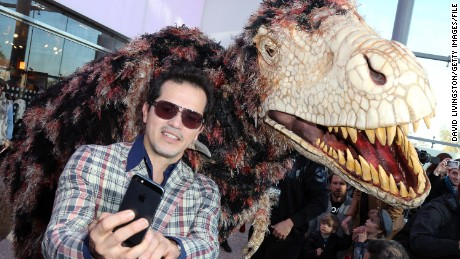"Actor John Leguizamo shoots a selfie at the ""Walking with Dinosaurs"" press event at the Los Angeles Natural History Museum."